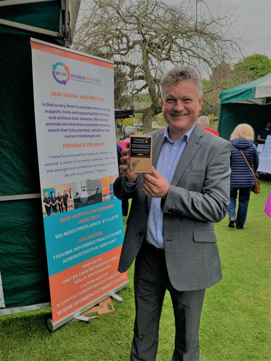 Mike Starkie with homeless hostel at traders market calderwood House Coffee